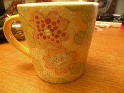 2005 Starbucks spring flower 16 oz mug, yellow green pink
