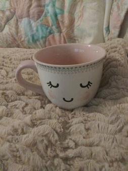 10 Strawberry Street Mug smiley face closed eyes thumbprint
